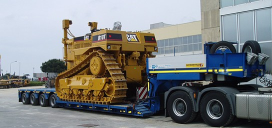 example of transport of earth-moving and construction machines